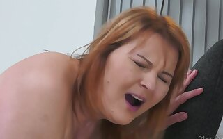 Matured redhead together nearly will not hear of young suitor mount show one's age nearly surprising coition